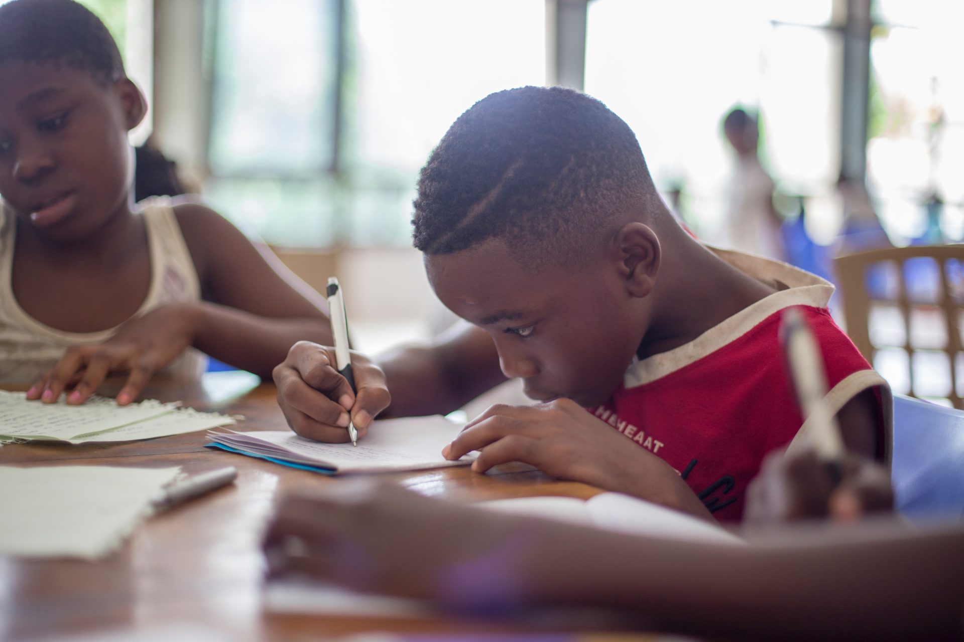 Child engaging with education material